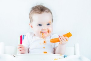 baby with carrot intro solid foods