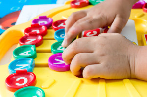 Asian children's Hand  to play alphabet games, Selective focus to Hand