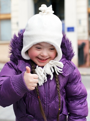 happy girl giving thumbs up